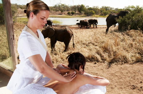 Guest enjoying a soothing spa and elephant sighting at the bush spa.