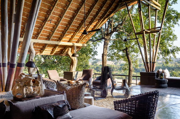 Relax and unwind on the Singita Boulders Lodge deck lounge.