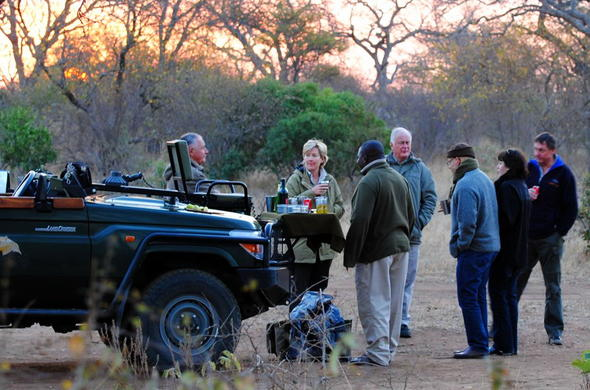 Enjoy sundowner drinks after a game drive.